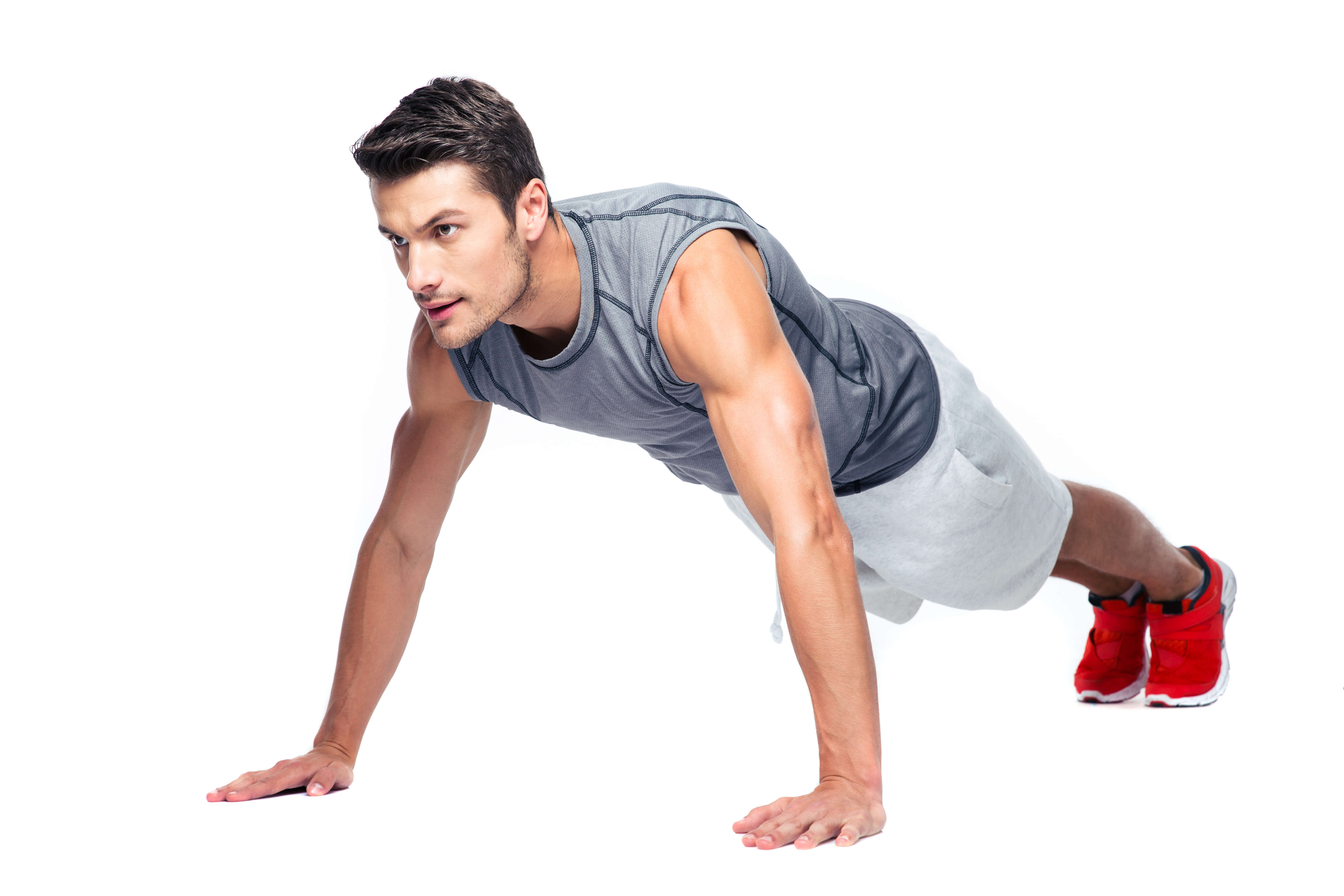 Group X fitness classes man in plank